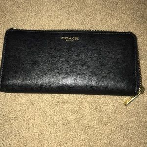 Black coach wallet with gold hardware